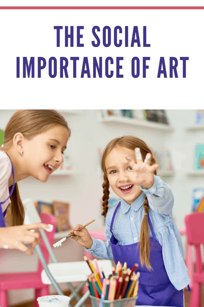two girls working on art together