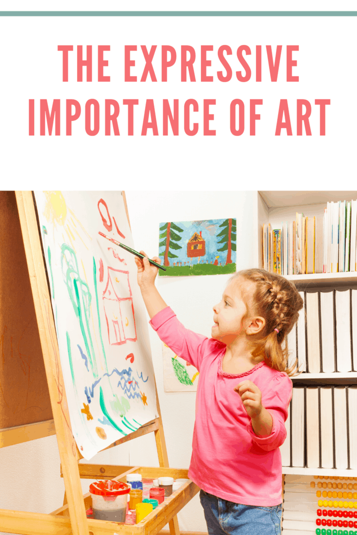 little girl painting a picture on paper on easel