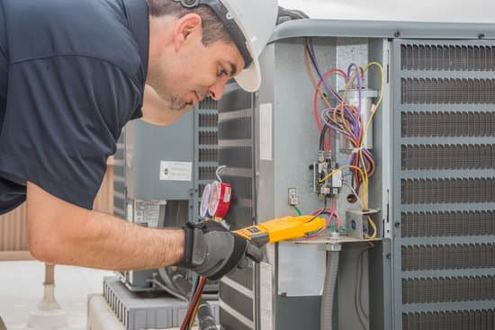 man repairing HVAC system one of the most common home repairs