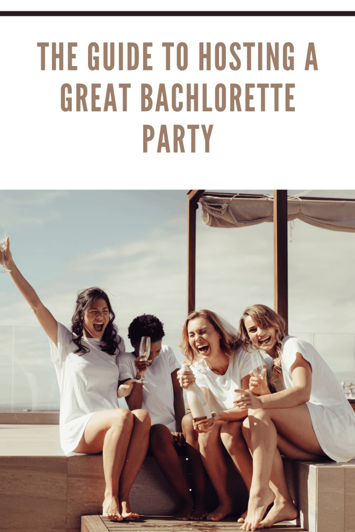 hens party with women in white, drinking wine and cocktails outdoors