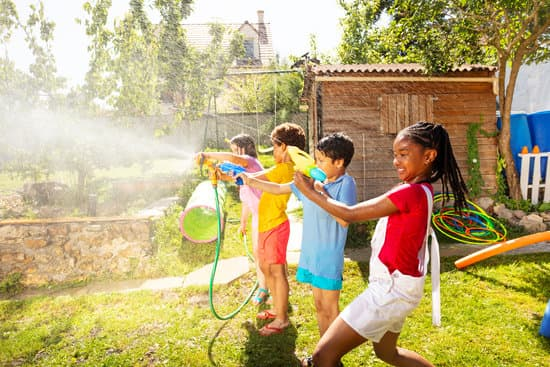 kids having a water fight at a do it yourself summer camp