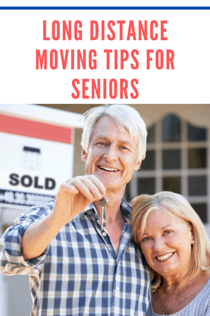 seniors moving holding keys after selling home