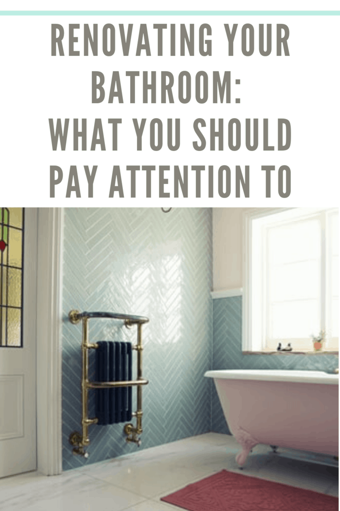 renovated bathroom in soft pastel blue/green and pink hues