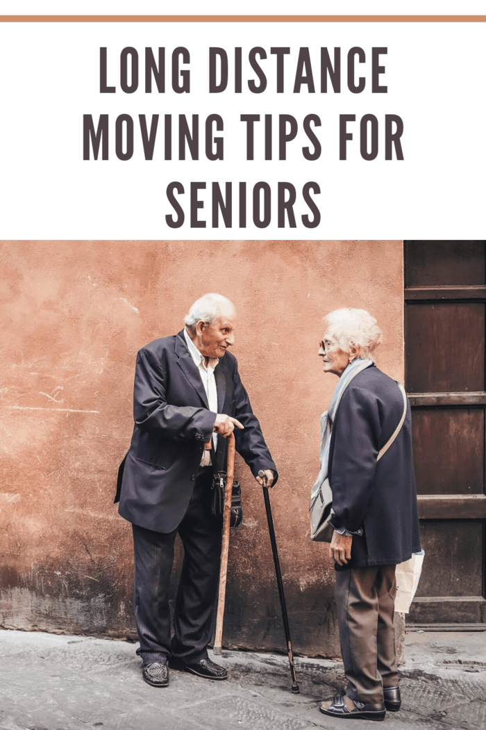 seniors conversing on sidewalk