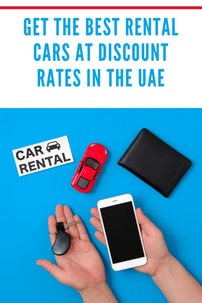 """Car rental app concept. Toy car, auto drive license, human hand with smartphone and car key, text sign """"CAR RENTAL"""" on blue background. Flat lay composition. Top view."""