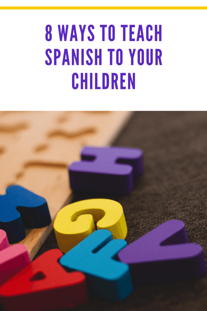 colorful alphabet letters made of wood scattered and ready for puzzle as one of the ways to teach your child spanish