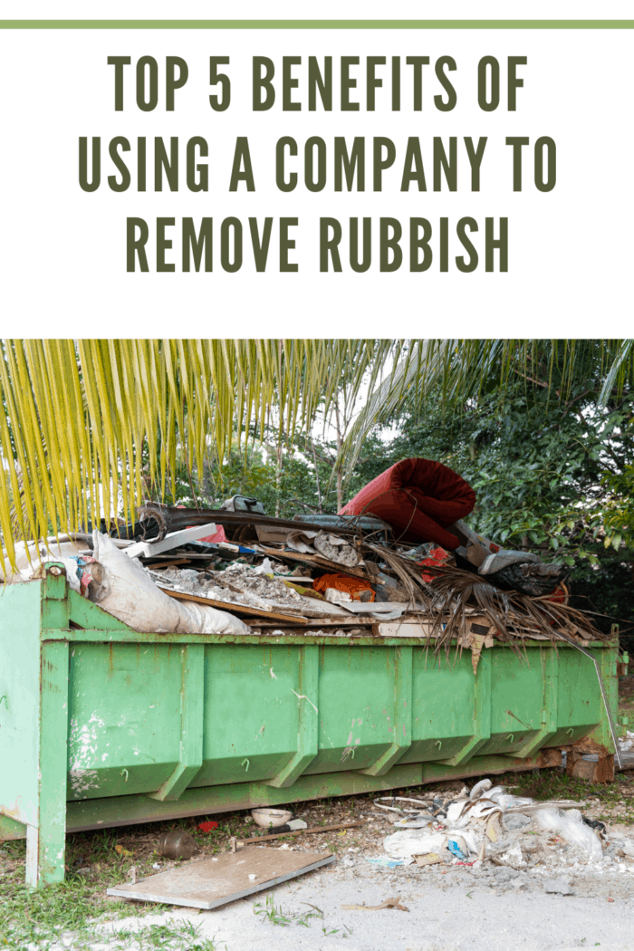 Removal rubbish dumpster bin with load of material for disposal from construction site