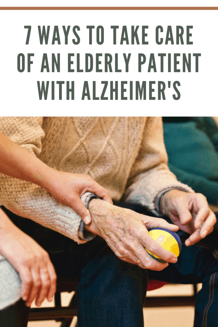 elderly patient with alzheimer's being cared for and using ball for therapy