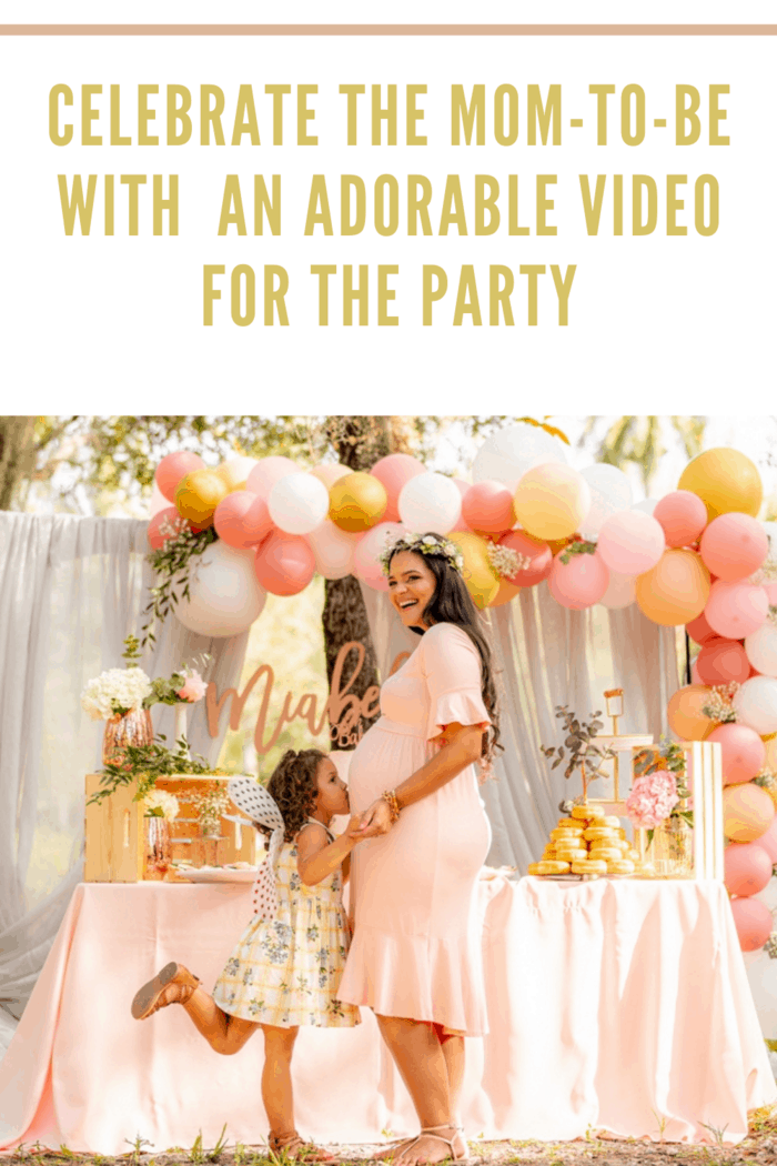 expecting mother with small child at baby shower with peach and gold theme