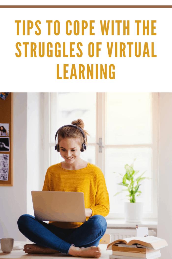 teen in yellow shirt with headphones sitting on windowsill doing online studies