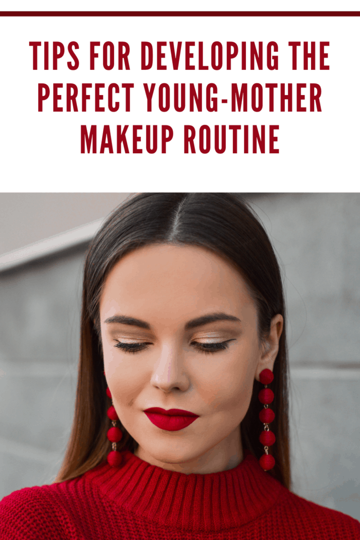 young woman perfecting young mother makeup routine with bold red lips