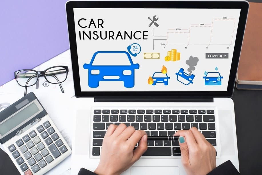 business hand using computer with car insurance policy page for car insurance renewal concept accident prevention coverage.