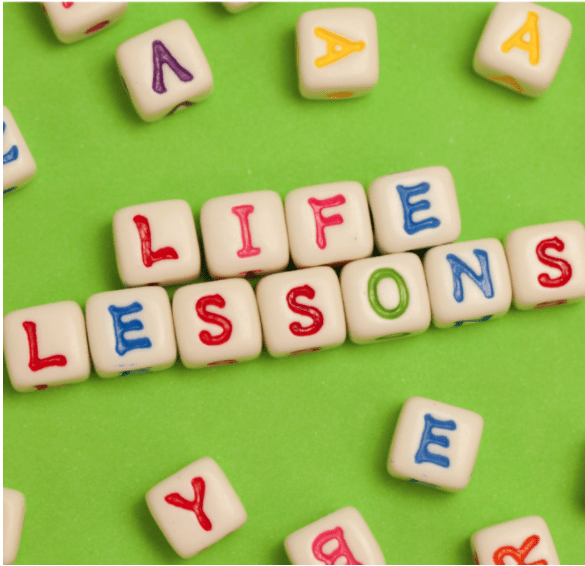LIFE LESSONS spelled in letters on a green background