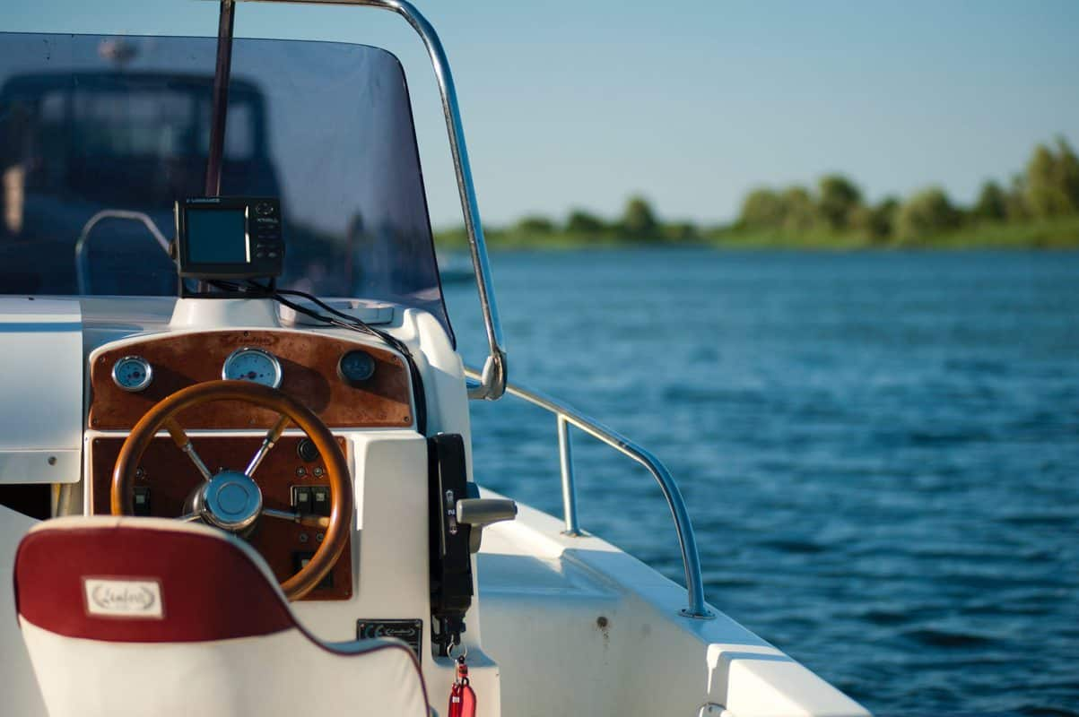 boat on water with view of steering wheel