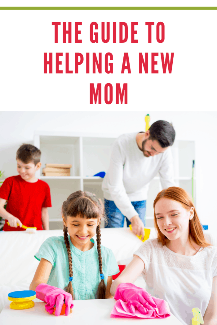 Happy family of four is cleaning their house to help a new mom