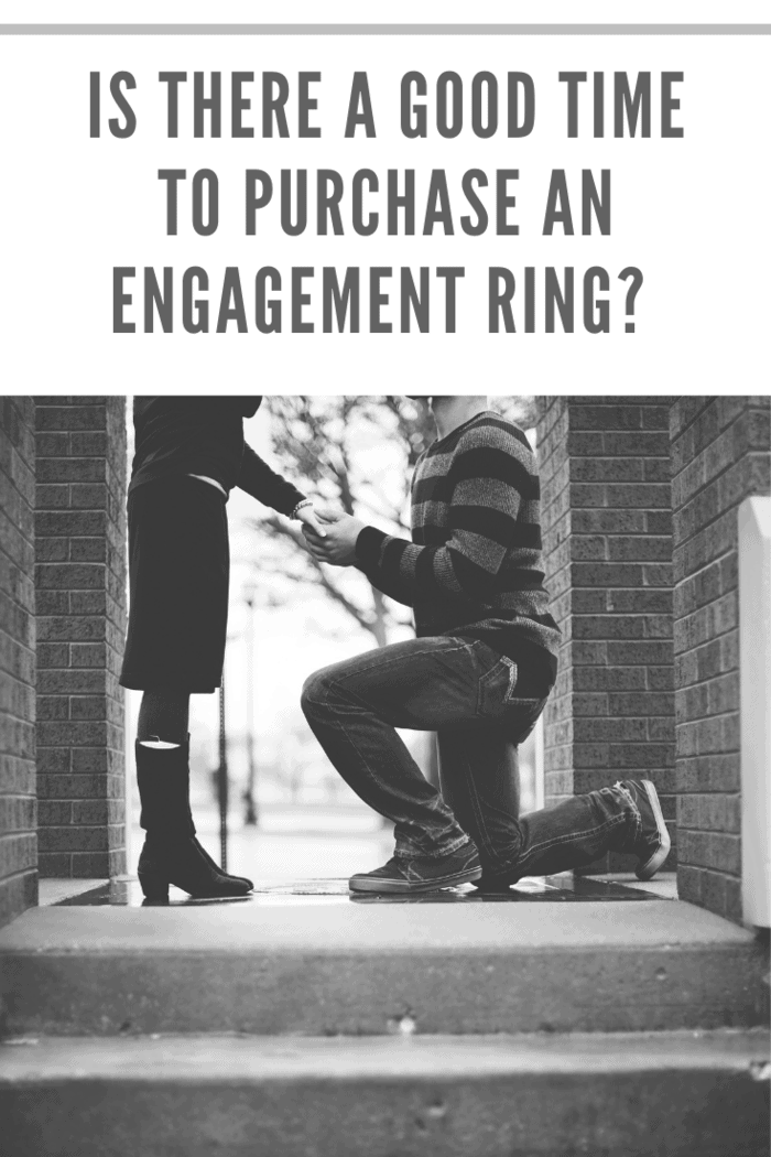 black and white photo of man on one knee proposing with engagement ring