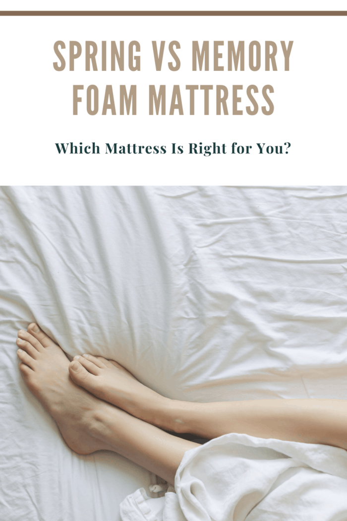 leggs and feet on mattress with white sheets