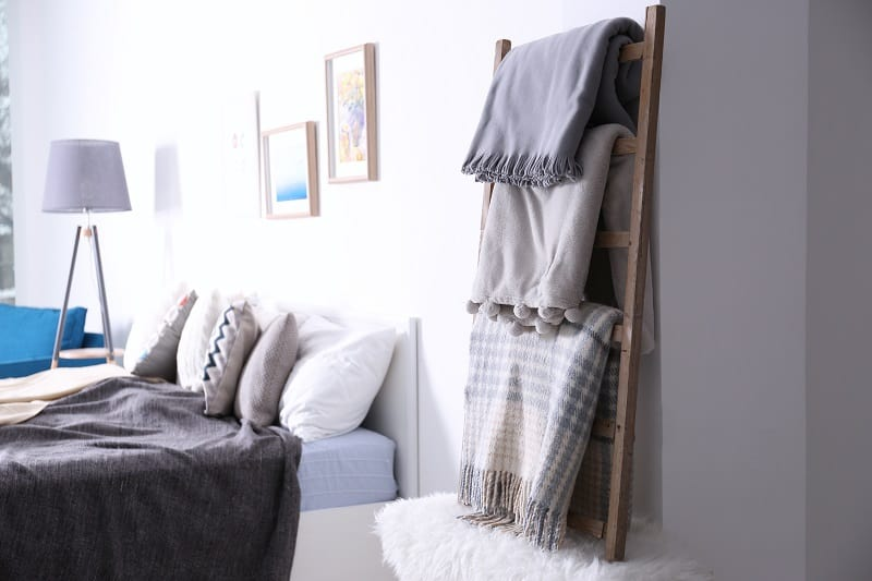 Warm plaids hanging on decorative ladder