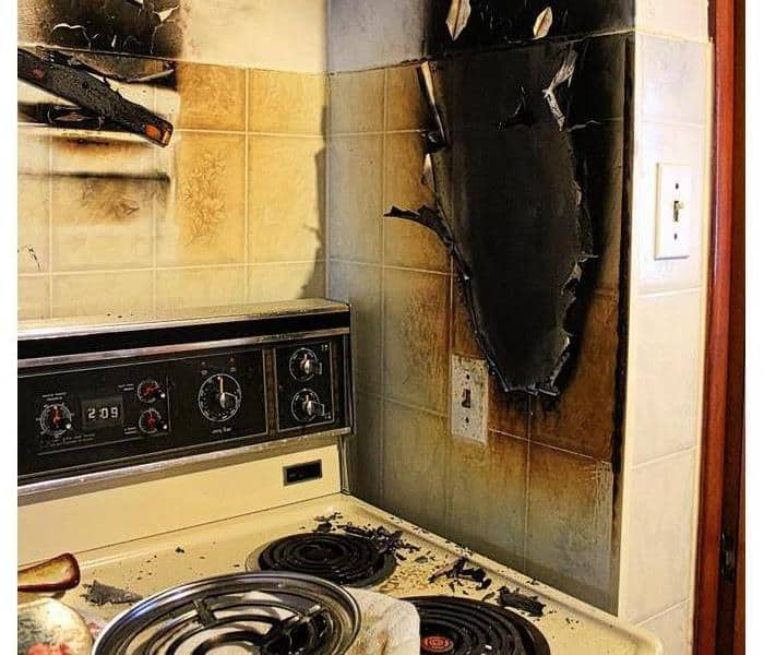 Damaged walls after a kitchen grease fire.