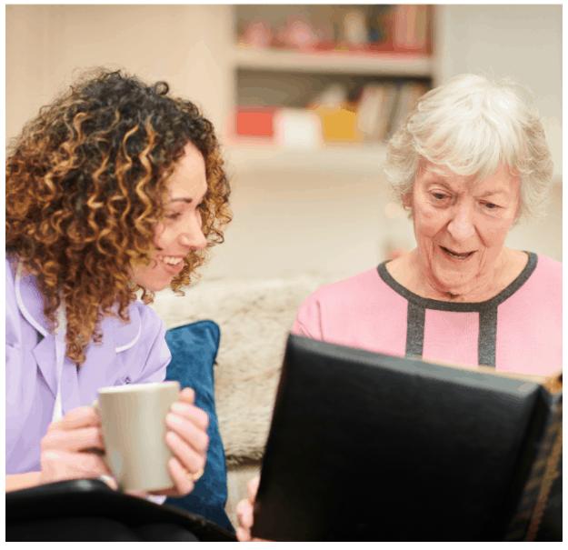 memory care nurse visit to senior woman
