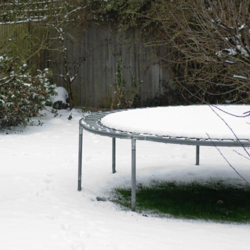 A trampoline in a domestic garden in Winter