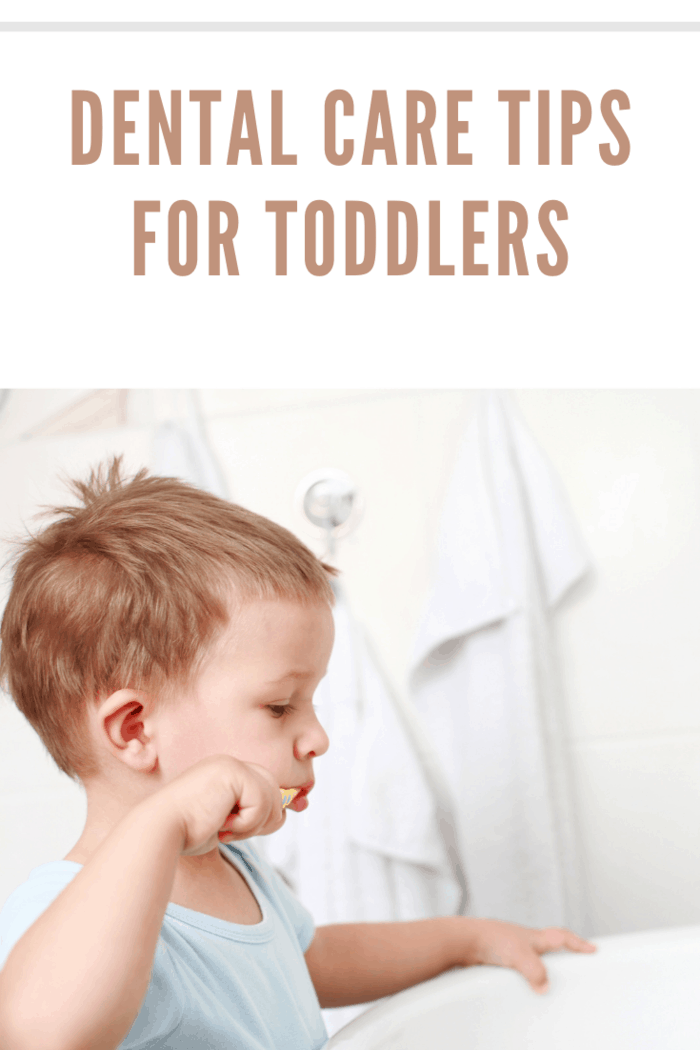 toddler practicing dental care tips by brushing his teeth
