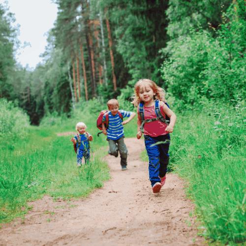 happy kids hiking- boy and girls hiking