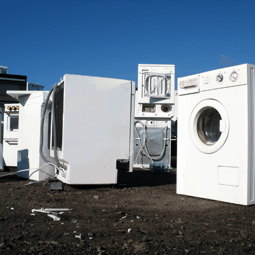 White goods in a dump with no visual brand names.