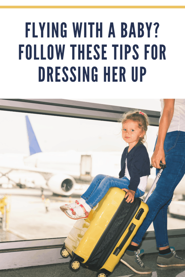 Mom carries your luggage with happy baby at the airport terminal. Flying for holliday, traveling with you luggage safety through Singapore airport. Use businesses class for you comfort