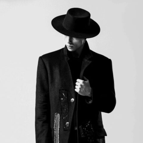 Man in a Black Coat and Hat