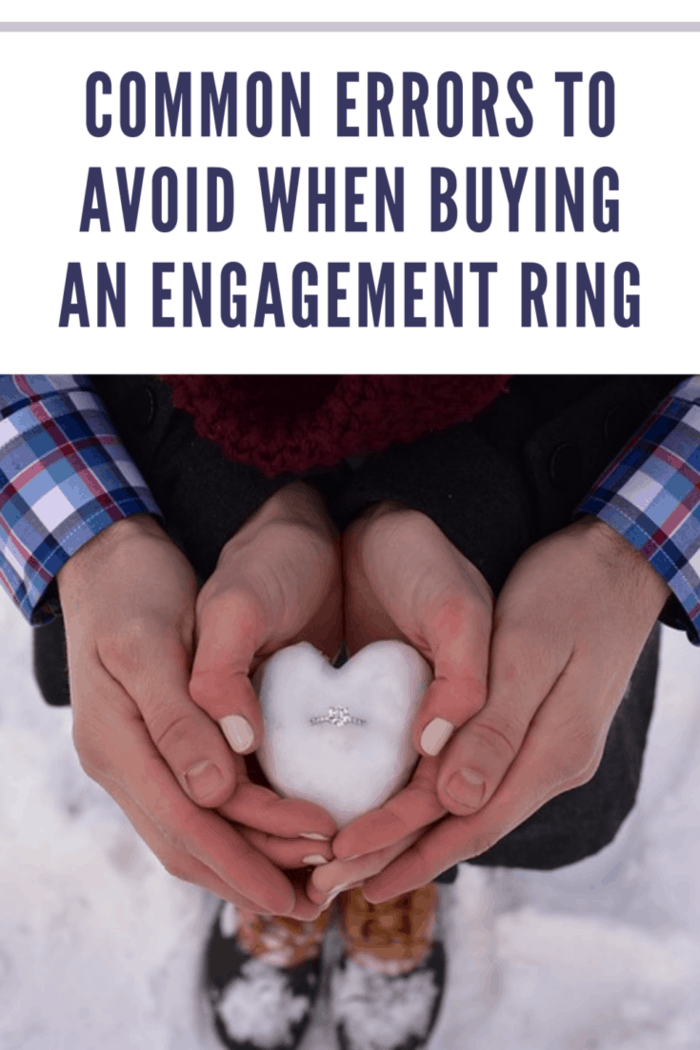 engagement ring in heart shaped snowball being held by couple