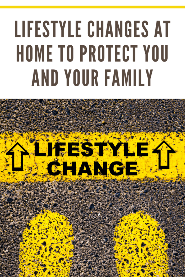 Lifestyle Change message. Conceptual image with yellow paint footsteps on the road in front of horizontal line over asphalt stone background.