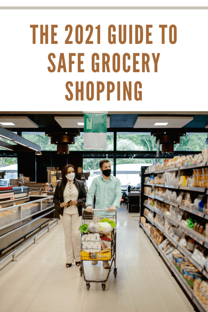 Couple shopping at grocery store, using face mask