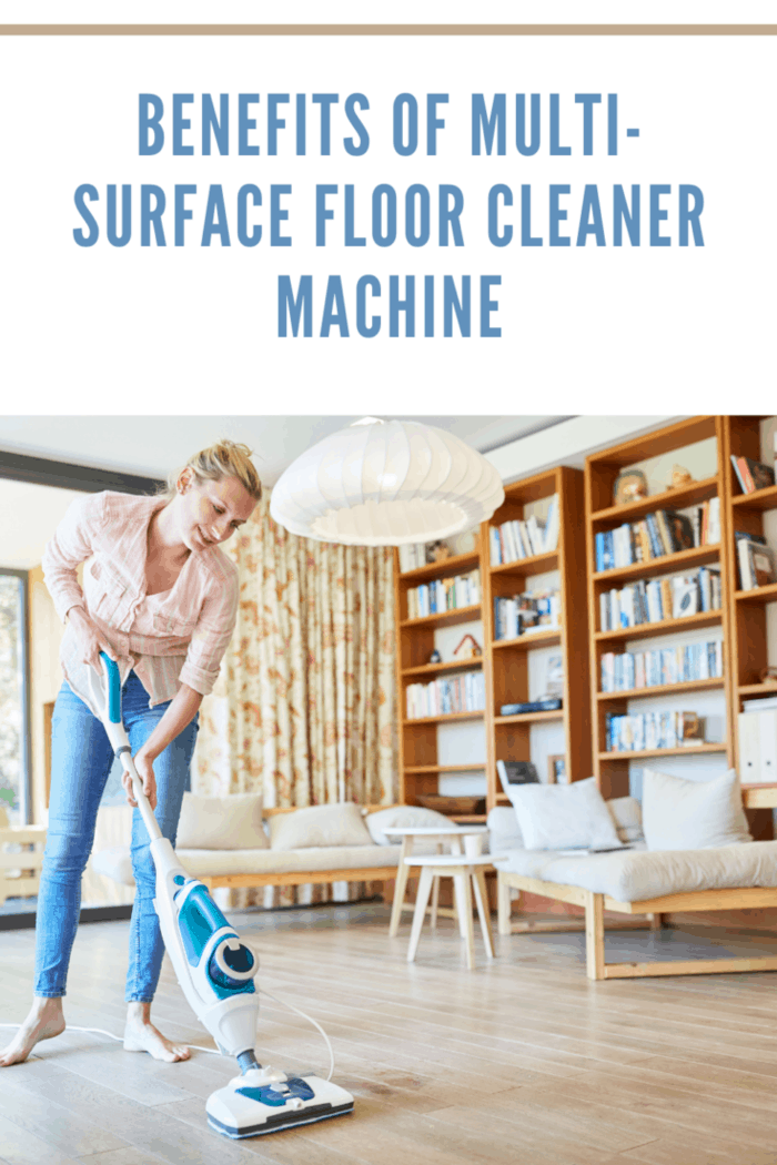 Woman cleans floor with steam cleaner in the living room at home