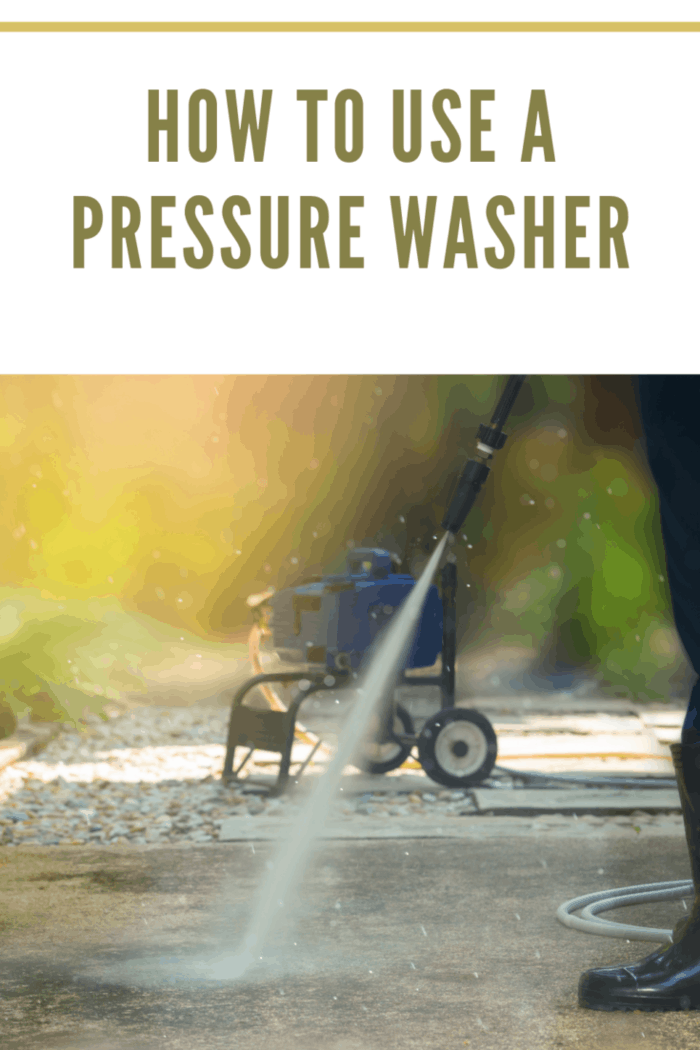 Man cleaning dirty walkway with high pressure water cleaner ,professional cleaning services concept.