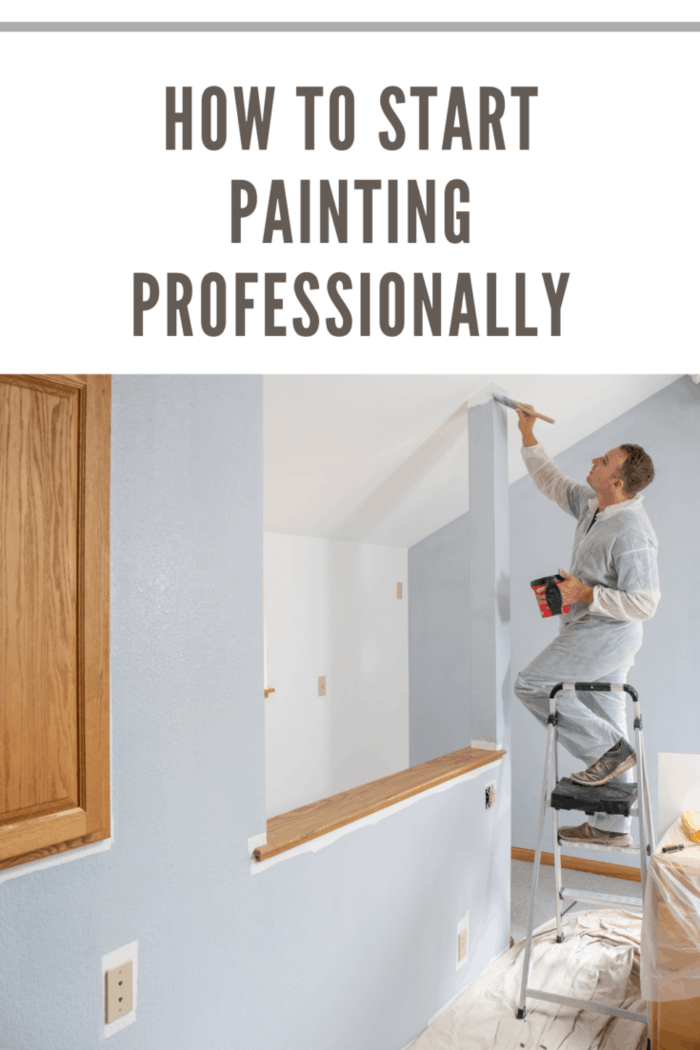 Professional painter painting room with gray paint.