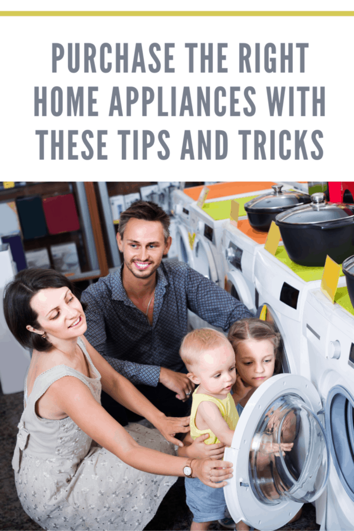 cheerful spanish parents with two kids choosing washing machine in home appliance store