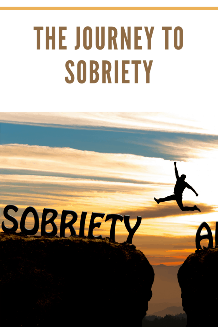 Happy man jumping from cliff of alcoholism to sobriety