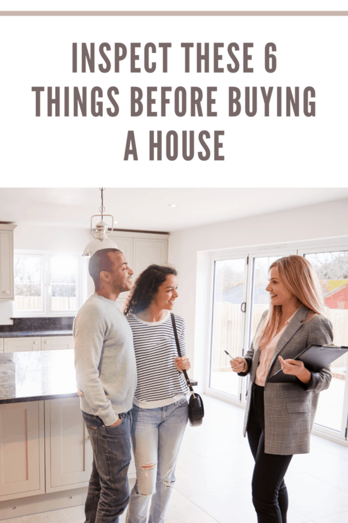 real estate agent with couple looking at home