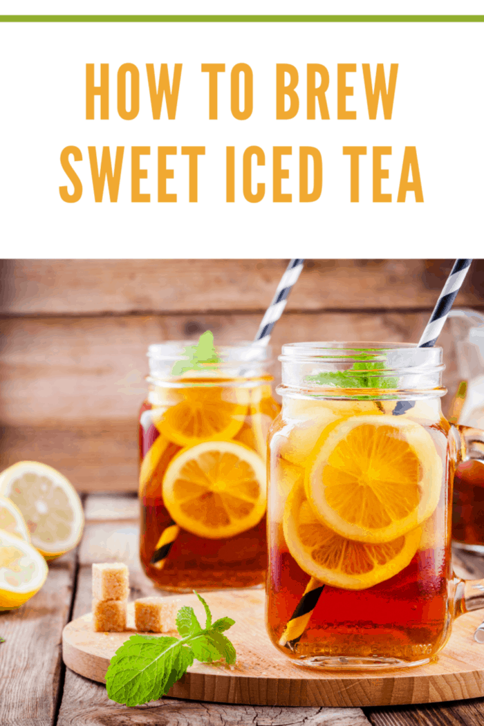 sweet iced tea with slice of lemon in mason jar on the wooden rustic background