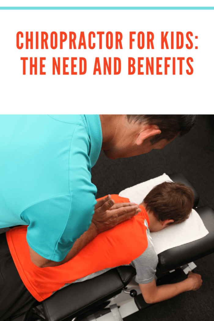 A chiropractor adjusting a boys spine