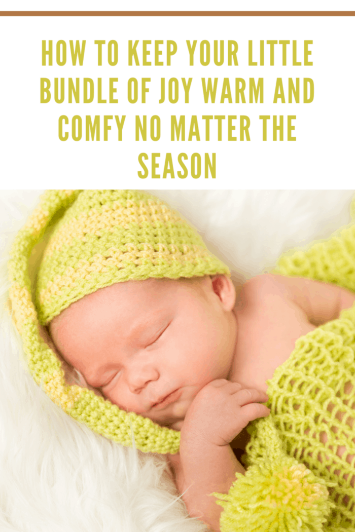 High Angle View Of A Baby In Green Warm Clothing Sleeping