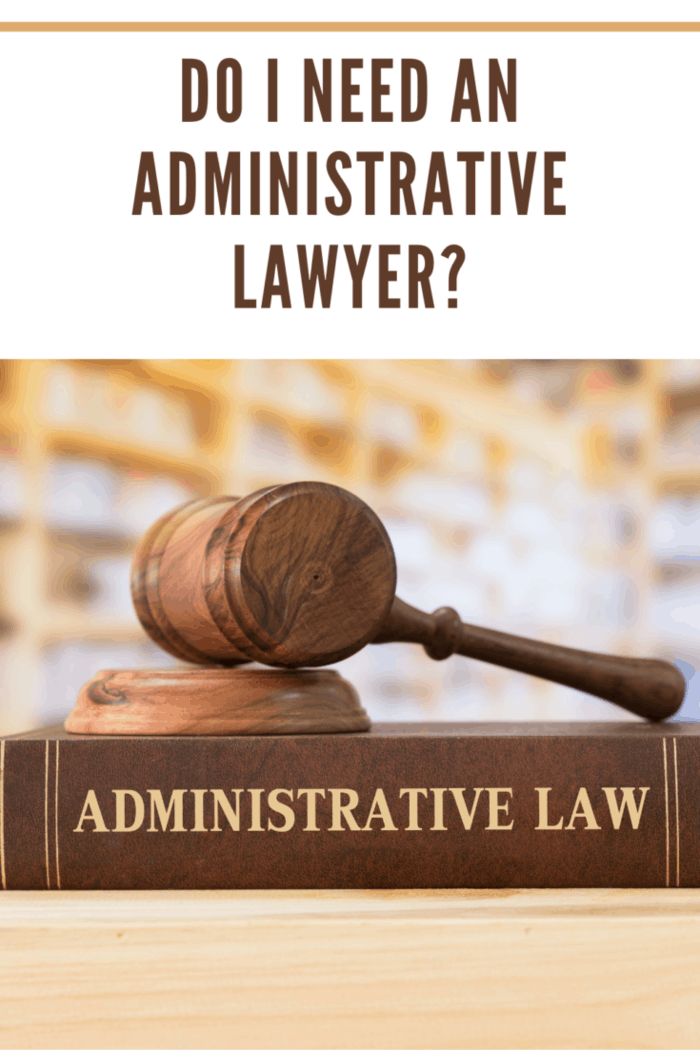 administrative law books and a gavel on desk in the library. concept of legal education.