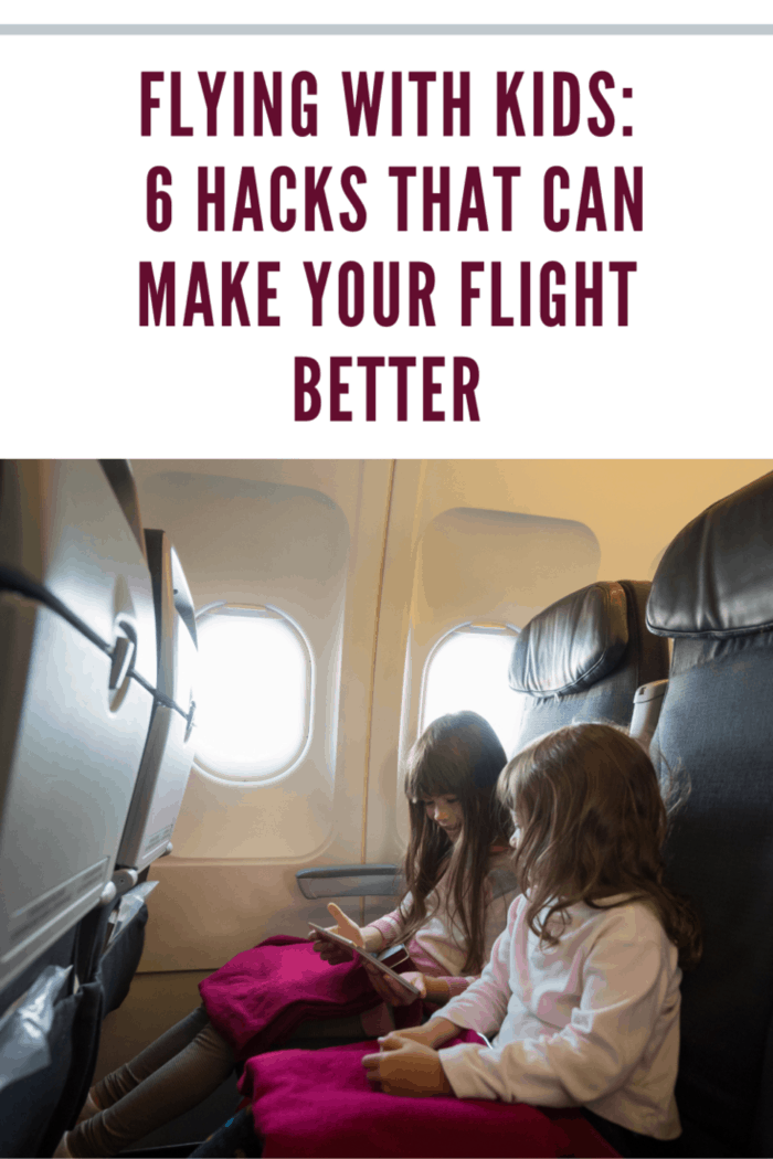 Children watching a tablet on an airplane