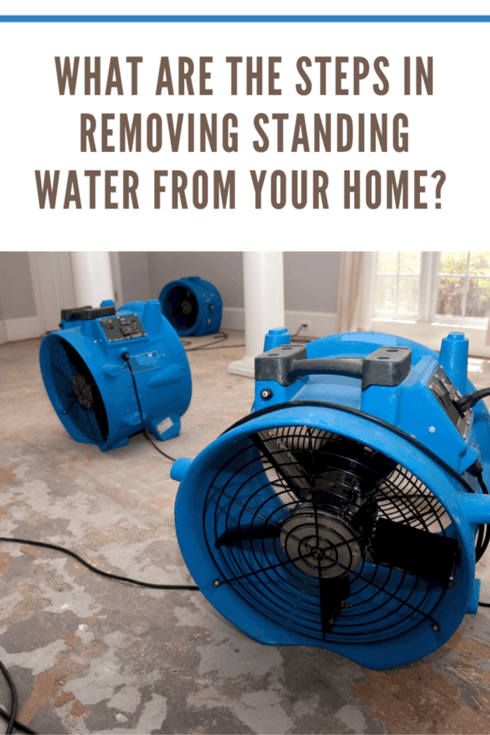 water damage recovery process in a residential home. The flooring is ripped off, and the rooms are sprayed with biowash. Industrial fans and dehumidifiers is placed in the room for the drying and restoration process.