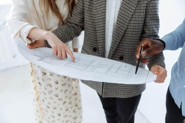 couple looking at blueprints to home