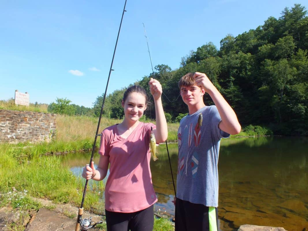 Cooper caught his SIXTH FISH! (So naturally, they posed together to celebrate catching fish at almost the SAME time!)