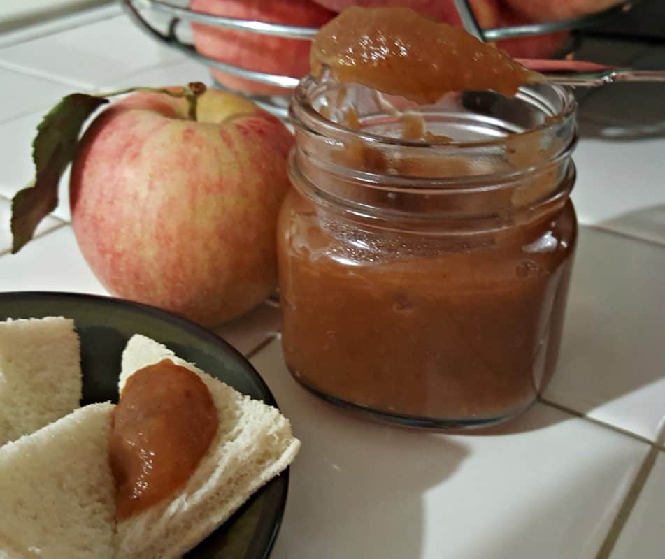 Easy Instant Pot Apple Butter on knife This Instant Pot Apple Butter recipe is a delicious preserve that can be used in place of any jam or jelly.