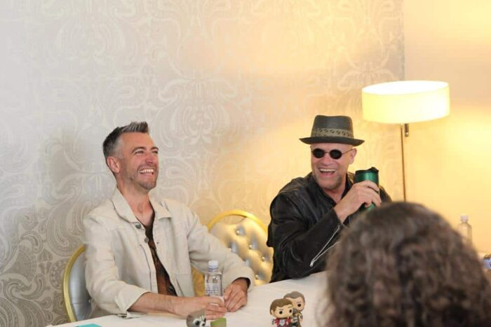 Sean Gunn laughing with Michael Rooker