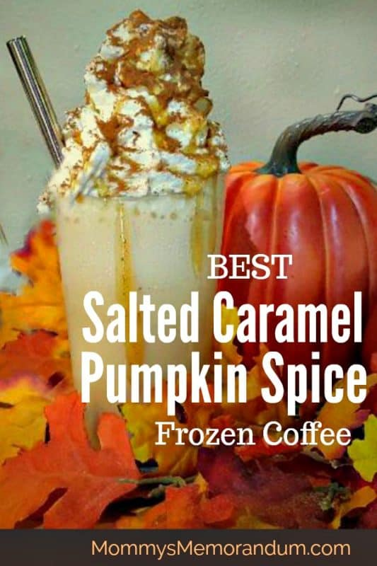 starbucks copycat salted caramel pumpkin spice frozen coffee heaped with whipped cream in fall foilage with pumpkin